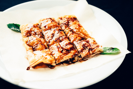 fresh rolled stuffed crepes on plate