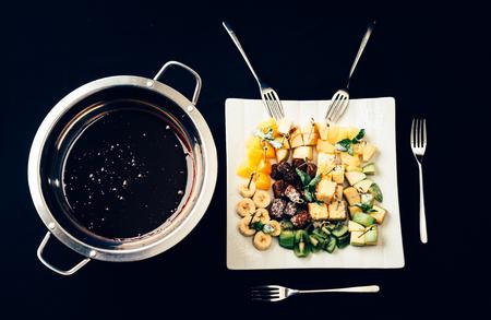 Chocolate fondue with fruits