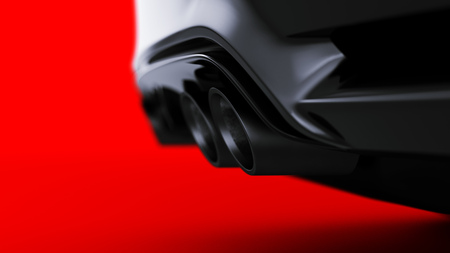 exhaust of black sports car on red