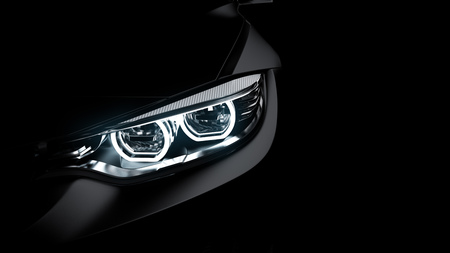 headlights of black sports car on black Stok Fotoğraf