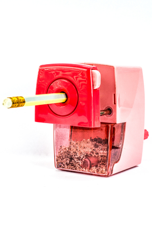 writing materials: Pencil Sharpener pink color isoleted on white background Stock Photo