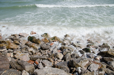 lucid: Rocky beach by the waves.