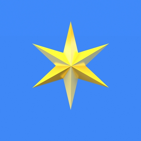 Gold Christmas star isolated over a blue background photo