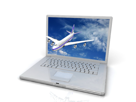 Professional Laptop and flying jet airplane photo
