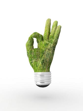 3D lightbulb - hand OK with grass. Concept - eco energy. photo