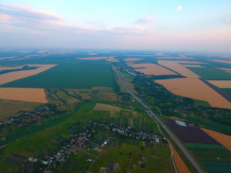 Aerial view of beautiful village, houses, roads. Sky, clouds. Standard-Bild