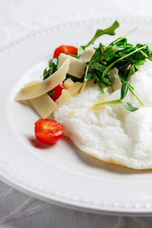 rukola: Fluffy Egg White Omelette with rukola, cheese and cherry tomatoes. White dish. Without yolk