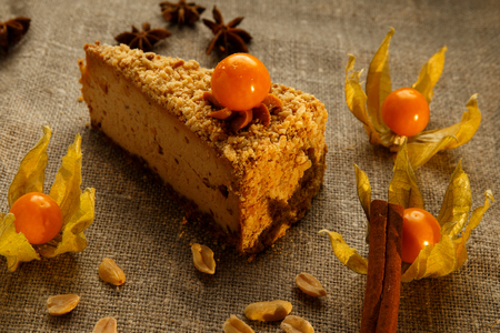 Peanut cream cheese cake with cape gooseberries. Reklamní fotografie