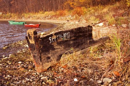 wreck boat on the lake shore Stock Photo