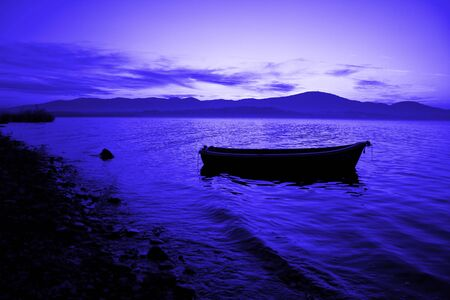 boat in the water lovely sunset blue color