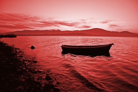 boat in the water lovely sunset red color