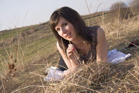 lovely looking brunette on meadow