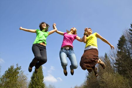 happy girls jumping high Stock Photo