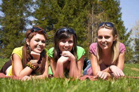 lovely girls relaxing on meadow photo