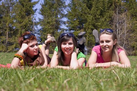 three lovely girls relaxing on meadow 2