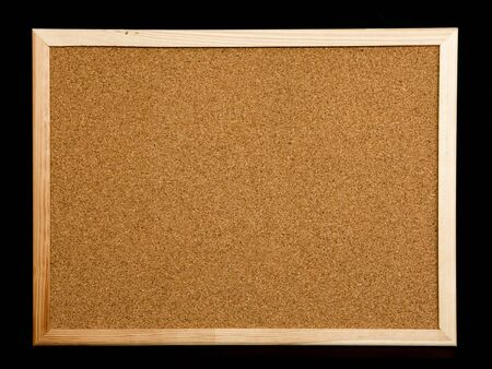 brown cork: cork board on black background Stock Photo