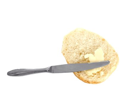 roll with butter and knife on white