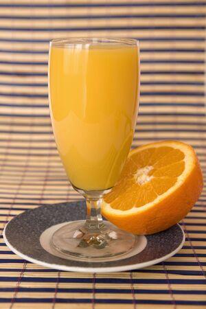 fresh orange juice on colored mat photo