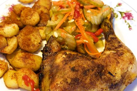 chicken with fried potato and salad
