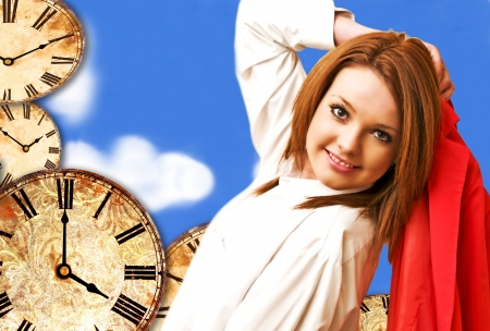 beautiful girl on clocks and blue sky background