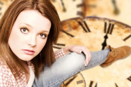 beautiful girl sitting on vintage clocks