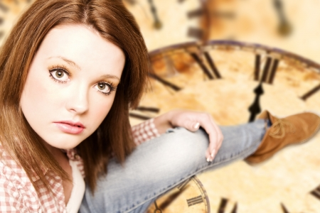 beautiful girl sitting on vintage clocks Stock Photo - 16847682