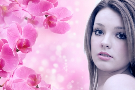nude fashion model: beautiful young woman with pink orchids