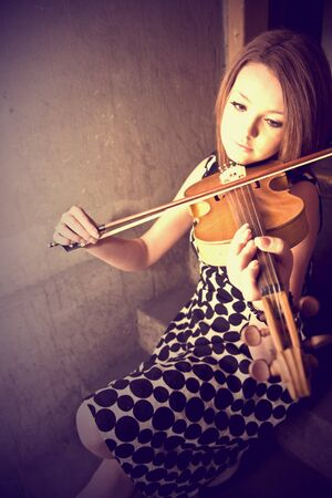 beautiful young woman with violins photo