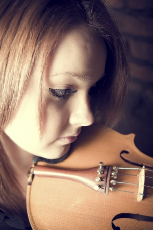 beautiful young woman with violins Stock Photo