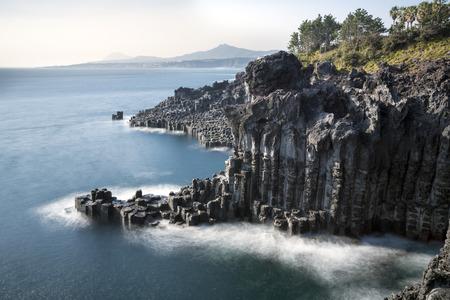 long exposure of wave in cliff in korea