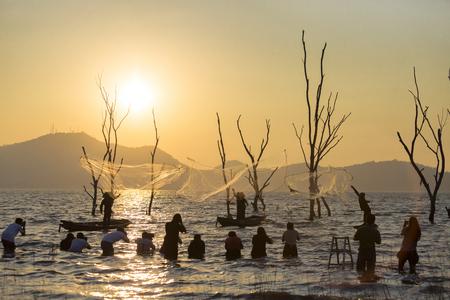 group of photographer taking photo of fisher man throwing fishing net Zdjęcie Seryjne