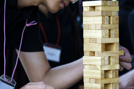 Man concentrate during play wooden jigsaw game