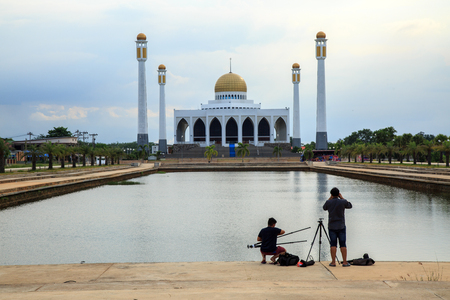 photographers are preparing equipment to shooting landscape of mosque
