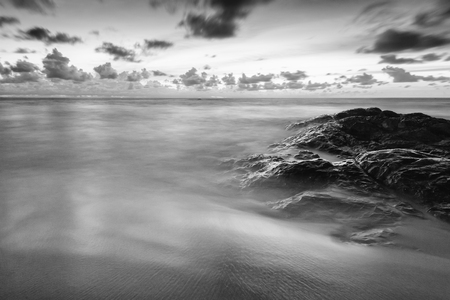 Black and white of wave and stone