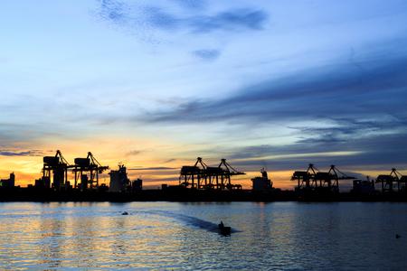 landscape of crane in port during sunrise