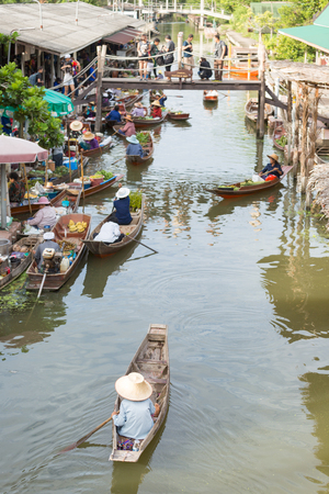 rowd of people selling and buying at traditional floating market