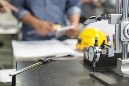 instrument in fabrication shop background with man working Zdjęcie Seryjne