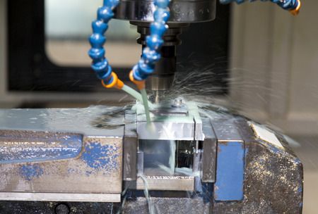 coolant water in CNC machine during machinary