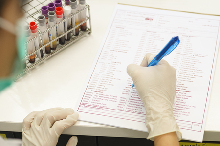scientist record information in check list for report