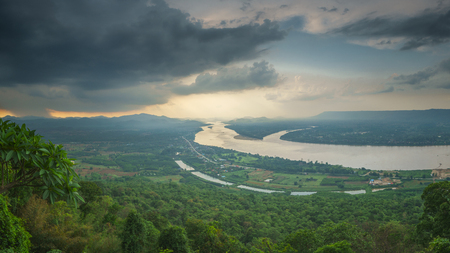landscape of river and mountain during raining come