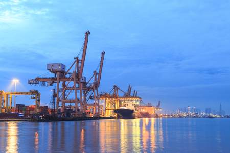 crane for container loading in port background with sunrise Zdjęcie Seryjne