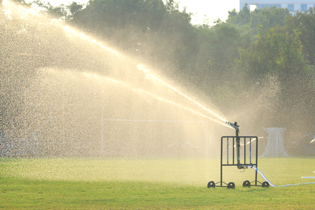 automatic sprinkler in football field Zdjęcie Seryjne