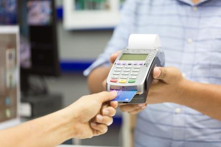business concept of payment by card swipe machine  Zdjęcie Seryjne