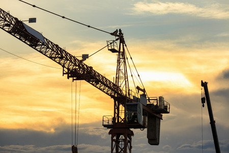 crane in construction site and sunset background