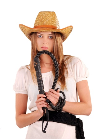 Girl in a hat and with a whip near her face