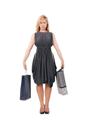 purchased: young girl in a dress with two packages purchased things Stock Photo