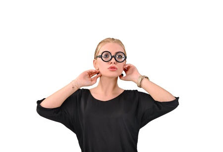 corrects: Girl with round glasses corrects hair