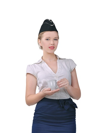 Stewardess with a cup of tea in hand photo