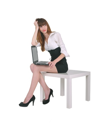 table skirt: girl sitting with a laptop Stock Photo