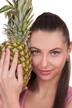 The girl holds pineapple